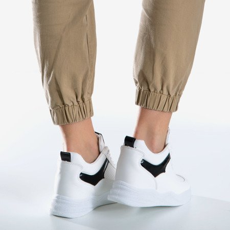 White and black sneakers on an indoor wedge Fassia - Footwear